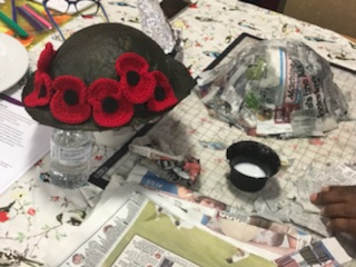 Poppies on hat with paper mache hat