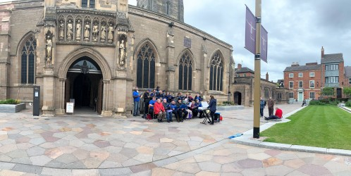 Panoramic view of the choir, Cathedral main entrance and outside paving and grass